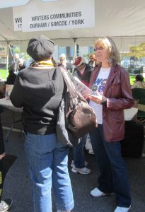 Helping to spread the word about Writers Community of Durham Region at Word on the Street, Toronto.